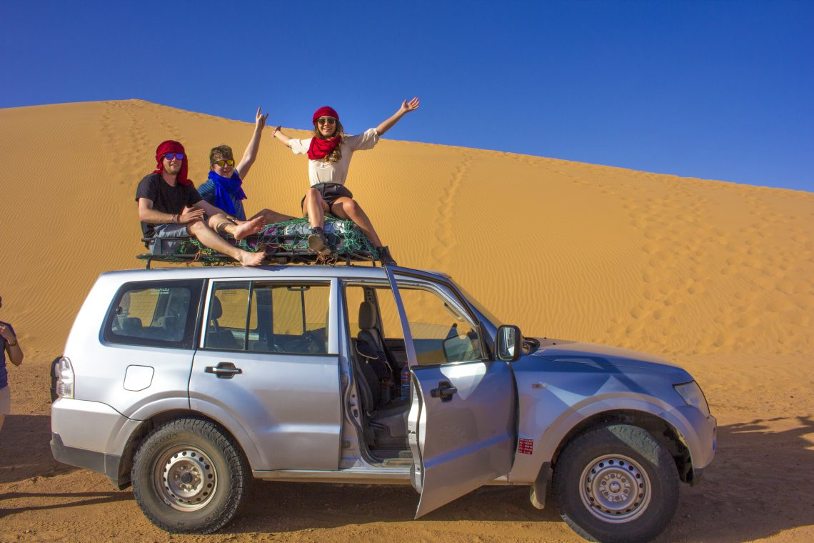 on top of car in sahara