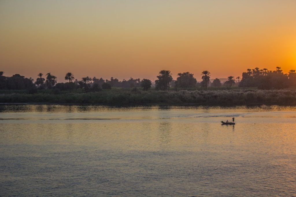 Man in boat Sunset over the Nile Egypt Travel Talk Tours Solo Femele Travel